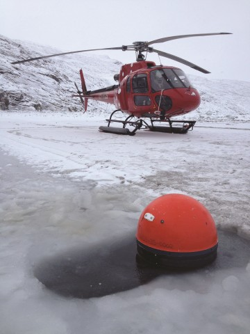 Fig. 1. A drifter being deployed through the ice in February 2012. Credit: K. Lennert