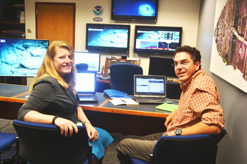National Oceanic and Atmospheric Administration (NOAA) biological oceanographer Mike Ford (right) and NOAA field operations specialist Kasey Cantwell (left) at the agency's exploration command center in Silver Spring, Md. Credit: Randy Showstack