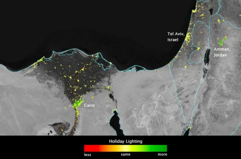 Image of a portion of the Middle East, showing areas where lights during Ramadan are brighter than long-term averages. Dark green pixels show the location of lights that are at least 50% brighter. Image by Jesse Allen, NASA's Earth Observatory.