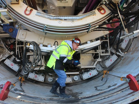 D.C. Clean Rivers Project manager Carlton Ray, explaining how the tunnel boring machines work. The machine he is walking on is named Nannie, for 20th century African-American educator, civil rights activist, and D.C. resident Nannie Helen Burroughs.  Credit: Randy Showstack