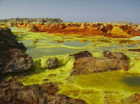 The otherworldly landscape of Ethiopia's Dallol Basin, a volcanic caldera in the Afar Triangle, shows sulfur mounding on brine pools. Photo by Achilli Family, CC BY 2.0, http://bit.ly/Dallolbrine.