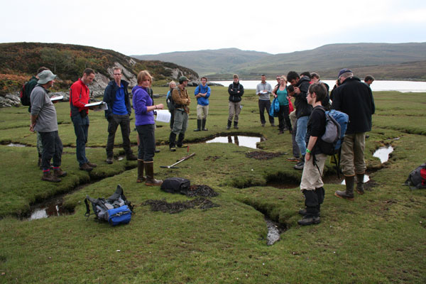 Workshop attendees hand-core sediments in Loch Laxford, a salt marsh within Assynt's post-glacial landscape. Credit: Tom Bradwell, BGS