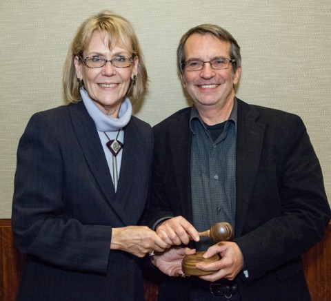 Incoming AGU President Margaret Leinen passes the gavel to President-elect Eric Davidson. The president-elect chairs the AGU Council. © Gary Wagner Photos