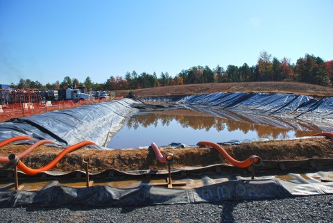 A water impoundment at a drill pad in the Fayetteville Shale gas play of Arkansas. The water will be used in the hydraulic fracturing process, where it will be combined with chemicals and sand, then used to create artificial fractures in gas-bearing rocks to allow the gas to be recovered. Credit: Bill Cunningham, USGS