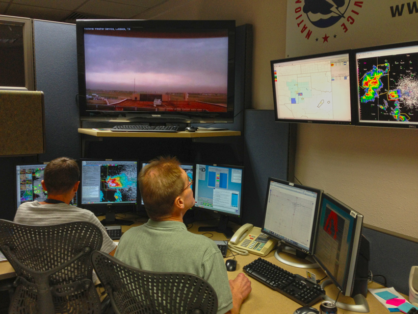National Weather Service Forecast Office Lubbock (Texas) on duty during a severe weather event. Note the tornado warning on the rightmost display unit. Credit: NOAA/NWSFO