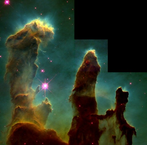 Iconic image of starbirth in the Eagle nebula, recorded by Hubble in 1995.  Newborn stars are emerging from pockets of interstellar gas. The stars lie at the tips of giant columns of gas and dust, which are the cocoons in which the newborns are incubated.  Jeff Hester and Paul Scowen, ASU; NASA/ESA