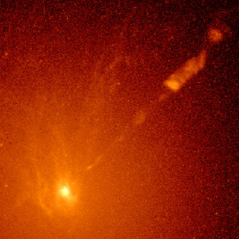 Hubble image of a spiral-shaped disk of hot gas at the core of the galaxy M87. Measurements with Hubble in 1994 showed that the disk is rotating so rapidly so close to the galaxy's center that only the tug of an ultraheavy object—a supermassive black hole—could account for the disk's motion. Credit: Holland Ford, STSI/JHU; Richard Harms, Applied Research Corp.; Zlatan Tsvetanov, Arthur Davidsen, and Gerard Kriss , JHU; Ralph Bohlin and George Hartig, STSI; Linda Dressel and Ajay K. Kochhar, Applied Research Corp.; and Bruce Margon, UW; NASA/ESA