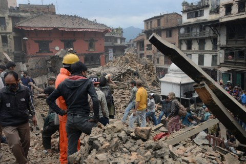 People clear rubble in Kathmandu's Durbar Square, a U.N. Educational, Scientific and Cultural Organization (UNESCO) World Heritage Site severely damaged by the 25 April earthquake. Credit: Prakash Mathema/AFP/Getty Images