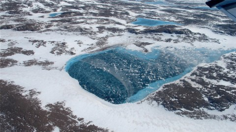 An aerial view of lake pooling on ice in Greenland. Credit: NASA/Jim Yungel, CC BY 2.0