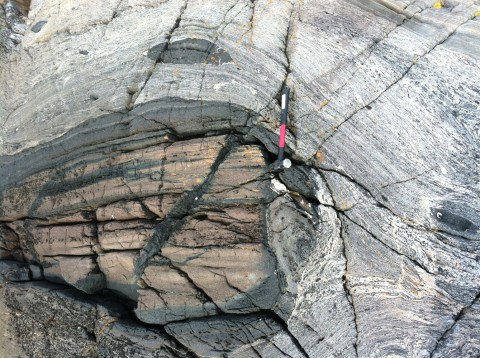 High-pressure, dense and strong eclogite (dark blocks), carried back to the surface from mantle depths by weaker, buoyant deeply subducted crust. Light-colored melts that cut these rocks were emplaced after eclogite rose from mantle depths. Credit: Andrew Kylander-Clark