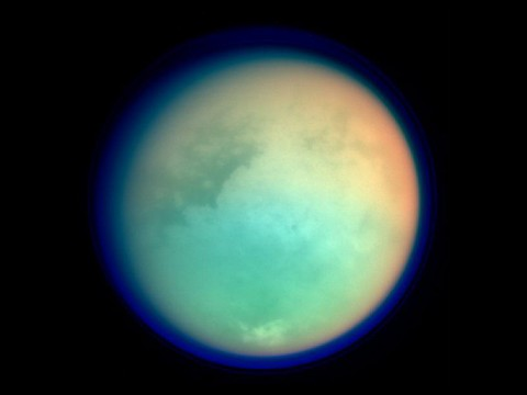 Saturn's moon Titan, photographed in ultraviolet and infrared by the Cassini orbiter