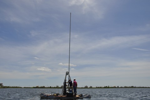 Scientists taking cores from Massachusetts' Salt Pond. The core recovered provides evidence of intense storm events going back approximately 2000 years. Credit: Richard Sullivan, WHOI