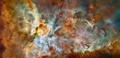 This composite image of the Carina nebula, a Milky Way star-forming region about 7,500 light-years from Earth, combines high-resolution Hubble observations taken at a single wavelength with a color palette derived from multiwavelength images recorded at CTIO in Chile. The image shows at least 12 bright stars that are 50 to 100 times as massive as the Sun. The image was released to celebrate Hubble's 17th birthday. Credit for Hubble data: NASA, ESA, N. Smith (University of California, Berkeley), and The Hubble Heritage Team (STScI/AURA). Credit for CTIO images: N. Smith (University of California, Berkeley) and NOAO/AURA/NSF