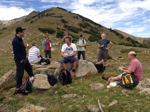 Scientists rest midway through a group hike during one day of a seismic hazards assessment workshop in the Colorado Rockies. The workshop used hiking as a way to foster a sense of camaraderie and create long, unguarded discussions among the hikers, despite heated debate around the workshop table. Credit: Ross S. Stein