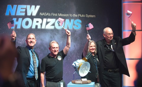 Officials with NASA and the New Horizons mission celebrate after confirmation that the Pluto-bound spacecraft successfully completed its flyby. Pictured, from left, are NASA Associate Administrator for the Science Mission Directorate John Grunsfeld, New Horizons Principal Investigator Alan Stern, New Horizons Mission Operations Manager Alice Bowman, and New Horizons Project Manager Glen Fountain. Credit: NASA/Joel Kowsky