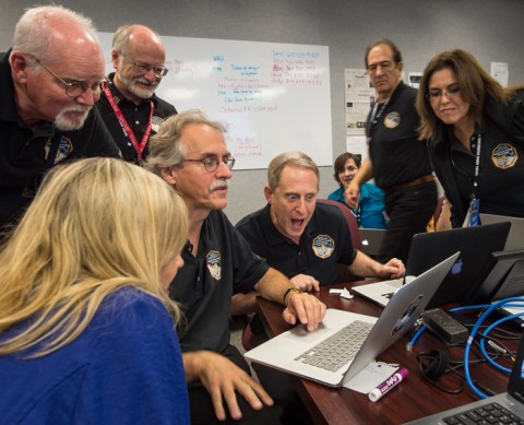New Horizons principal investigator Alan Stern, center, along with other team members, reacts as he views new images from the spacecraft for the first time yesterday at the Johns Hopkins University Applied Physics Laboratory in Laurel, Md. Credit: NASA/Bill Ingalls