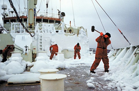 Scientists and crew members knock ice off the deck of the R/V Knorr during a research expedition in the Laborador Sea. Credit: George Tupper, WHOI