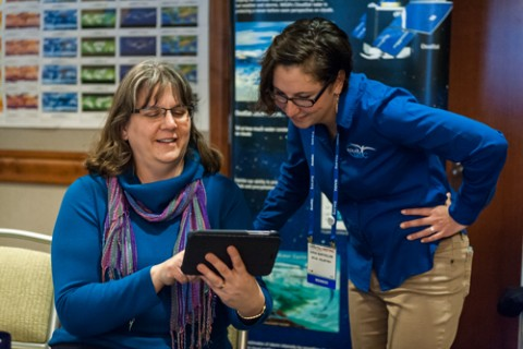 Sarah Bartholow (right), education project manager for PolarTREC, speaks with an AGU member at the 2014 GIFT Workshop. Credit: Karna Kurata