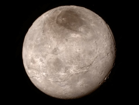 A swath of cliffs and troughs stretches about 600 miles (970 kilometers) from left to right across Pluto's largest moon Charon, suggesting widespread fracturing of Charon's crust, possibly a result of internal processes. The New Horizons spacecraft took this photograph Monday, 13 July, with its  Long Range Reconnaissance Imager (LORRI). Credit: NASA/JHU APL/SwRI
