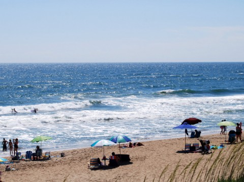 A rip current on North Carolina's Outer Banks. The rip current is visible in the center of the photograph where there is a flat spot in the line of breaking waves, and where foam is seen moving offshore. Credit: Gregory Dusek