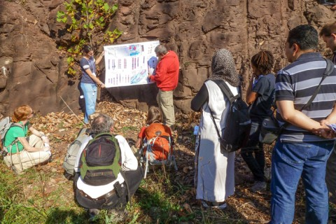 Graduate students and faculty participate in a field trip to the Newark rift basin, held the day before the GeoPRISMS Planning Workshop for the East African Rift System in Morristown, N. J., in October 2012. Here participants examine a normal fault developed in Late Triassic mudstone in Kintnersville, Pa. Credit: Anaïs Férot (GeoPRISMS).