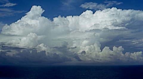 A typical large convective storm, probably without lightning, over the central Pacific Ocean. Ocean convection produces more total rain despite weaker updrafts, the strength of which defines the intensity of a storm and its capacity to develop lightning.  This photo was taken from a research aircraft south of Palmyra Atoll. Credit: Edward Zipser