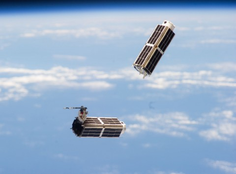 Two tiny satellites, known as NanoRacks CubeSats, speed through space last year after their February 2014 release from the International Space Station. Today, the U.S. National Reconnaissance Office (NRO) launched 13 other NRO- and NASA-sponsored CubeSats into space aboard a rocket. Credit: NASA