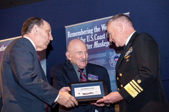 National Weather Service Director Louis Uccellini (left) and National Oceanic and Atmospheric Administration Deputy Undersecretary for Operations Vice Admiral Michael Devany (right) present a commemorative plaque to Richard Fodor. Fodor's older brother Lester died in September 1942 from a U-boat attack while serving as a weather observer for the U.S. Weather Bureau. Credit: NOAA