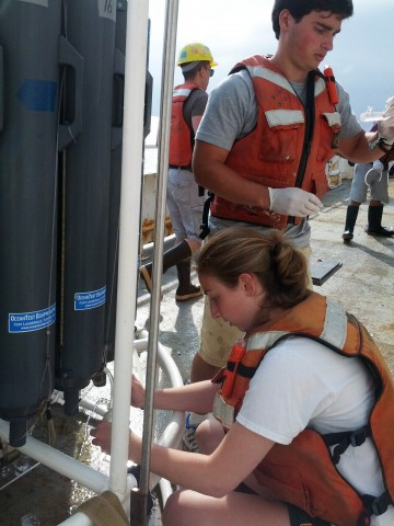Alexander Weinstein and Arielle Green, students in John Kessler's research group, collect water samples from Hudson Canyon aboard the R/V Endeavor in July 2014. Credit: John Kessler