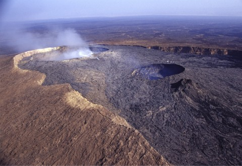 Overview of the northern part of the basaltic Erta Ale caldera, northern Afar (Ethiopia), filled with recent lava flows and hosting two pit craters, or collapsed vents. The southern pit to the right, several tens of meters wide and deep, has been hosting an active lava lake for more than a century. Credit: Valerio Acocella