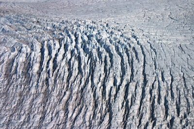 Crevasses open up as ice flows over a bedrock rumple in West Greenland. Credit: William Colgan