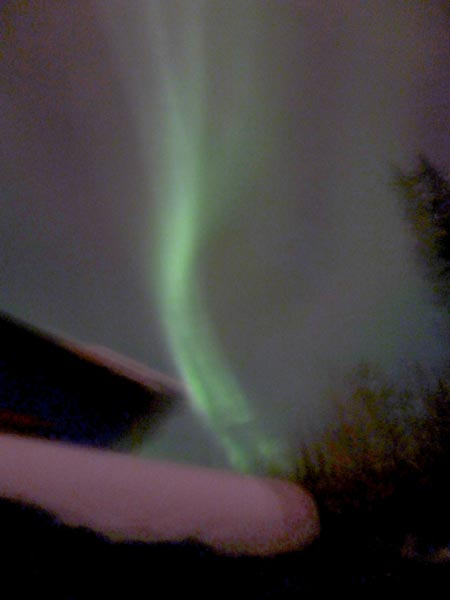 Auroral image taken after a record-setting snowstorm during the AGU Chapman Conference on Magnetospheric Dynamics.