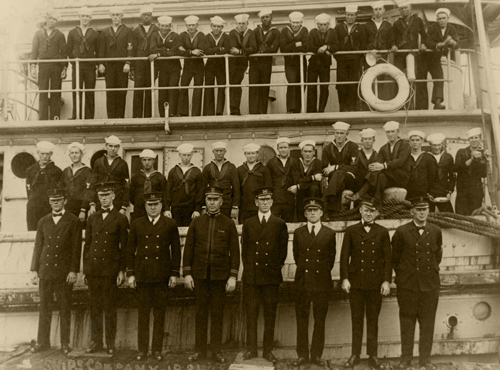 Ship's company beside and on USS Conestoga