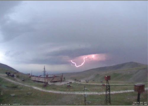 An instrument in the sensor network at Aragats Space Environmental Center captured this photo, which shows intracloud lightning below the network. Because the instrument station is located 3200 meters above sea level, clouds sometimes sit on or below the station. Credit: Cosmic Ray Division, Yerevan Physics Institute
