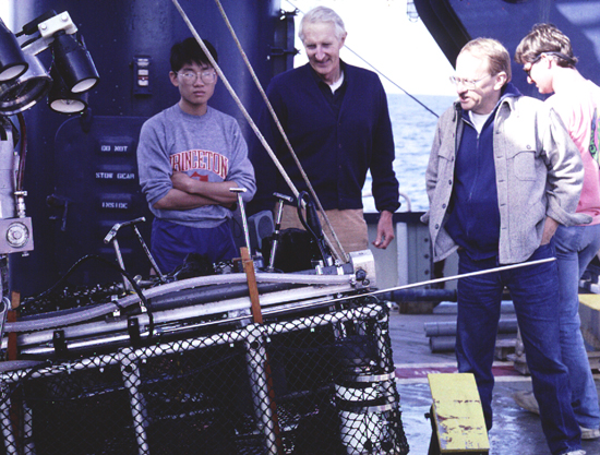 Dick and colleagues standing near Alvin's basket of instruments.