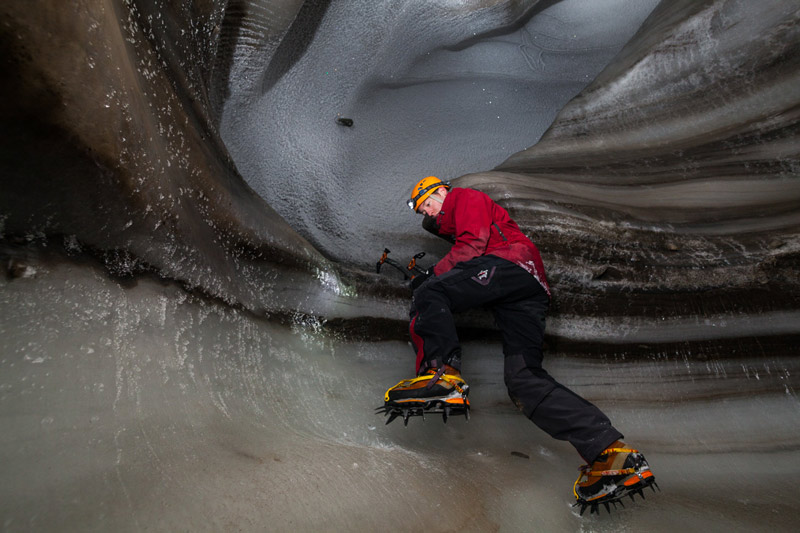 Stephen Jennings navigates the cave's icy walls with crampons attached to his boots.