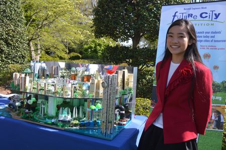 Student Sydney Lin poses with her team's model for a sustainable city at the White House Science Fair.