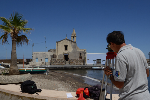 Scientists measure land subsidence effects on Lipari's coast.