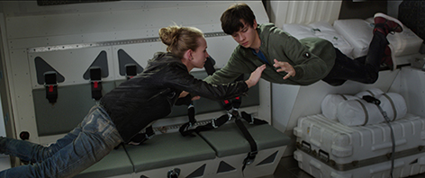 A 16-year-old born on Mars, Gardner Elliot, and Tulsa, the Earth girl he met online, get better acquainted in zero gravity. Credit: Courtesy of STX Entertainment. © 2016 STX Productions, LLC. All Rights Reserved.