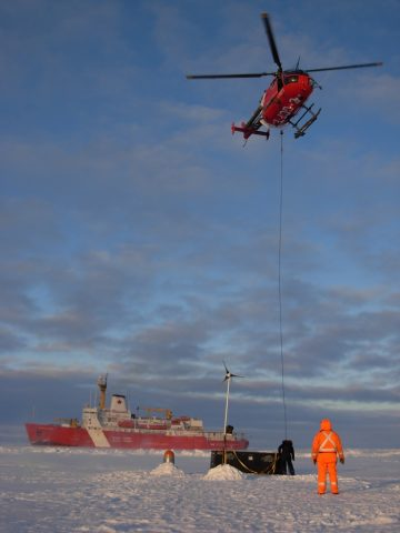 A box with deployment gear is slung back to the ship after installation of an Ice-Based Observatory during an expedition to the Beaufort Gyre region in 2010. Credit: Richard Krishfield, Woods Hole Oceanographic Institution
