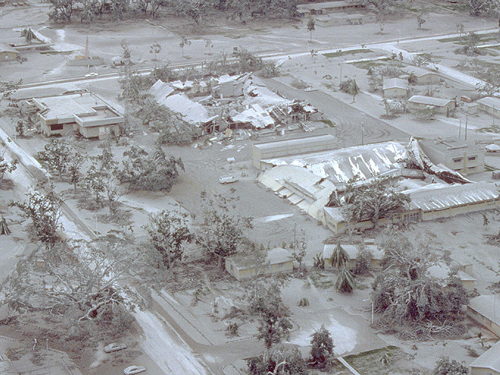 Aerial view of part of Clark Air Base on 24 June 1991 showing buildings and vegetation damaged by Mount Pinatubo's 15 June 1991 eruption.