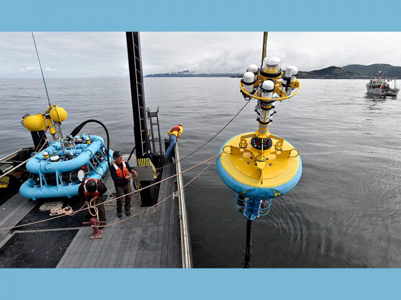 An Ocean Observatories Initiative (OOI) inshore surface mooring is deployed in June 2015 off the coast of Newport, Oreg., from Oregon State University's (OSU) R/V Pacific Storm. In the background, a team on OSU's R/V Elakha is deploying an OOI underwater glider. Photo Credit: Andy Cripe, Corvallis Gazette-Times