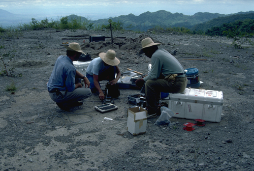 Scientists install electronic tiltmeters prior to Pinatubo's eruptions.