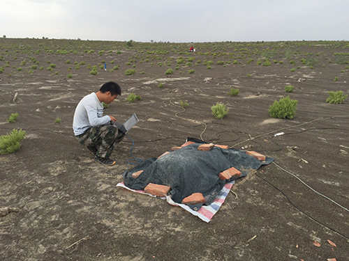 A student checks on magnetotelluric data quality in the western Junggar basin
