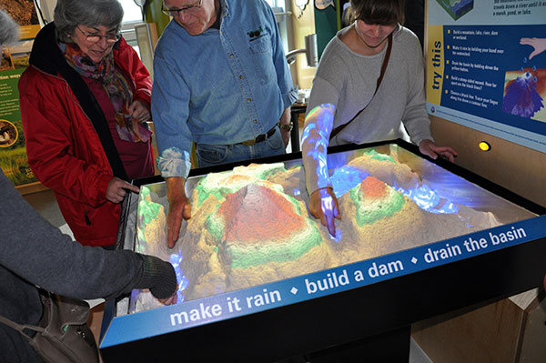 Visitors explore augmented reality at ECHO Leahy Center for Lake Champlain in Burlington, Vt.