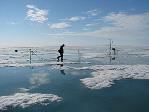Glaciologist Hajo Eicken maintains an ice growth and melt-monitoring station near Barrow, Alaska.