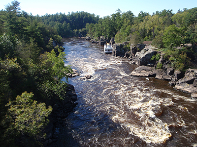 Exposures of the Midcontinent Rift's 1.1-billion-year-old volcanic rocks along the border between Minnesota and Wisconsin, where the St. Croix river cuts through a series of lava flows.