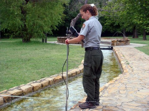 Hydrologic Technician Emily Clark takes monthly spring discharge measurements at Vendome Well to determine the rate of flow.