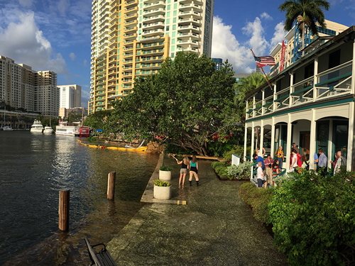 Workshop attendees learn about flooding at the Stranahan House in Fort Lauderdale, Fla.