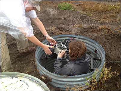 Kansas Geological Survey scientists install a seismograph to monitor induced seismicity in their state